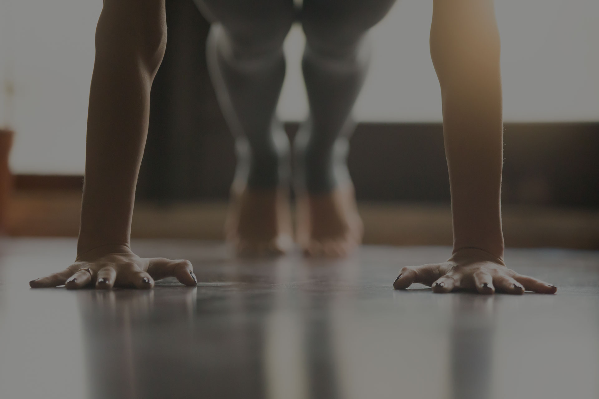Young yogi woman standing in Plank pose